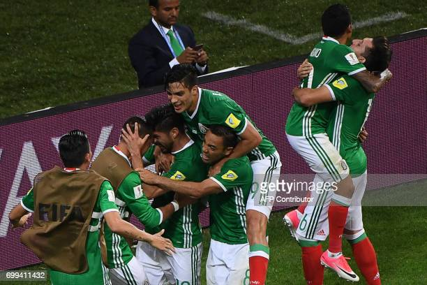 Mexico's forward Oribe Peralta celebrates with Mexico's forward Marco Fabian and Mexico's forward Raul Jimenez after scoring a goal during the 2017...