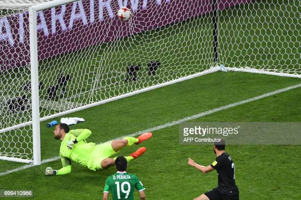 TOPSHOT Mexico's forward Oribe Peralta scores a goal past New Zealand's goalkeeper Stefan Marinovic during the 2017 Confederations Cup group A...