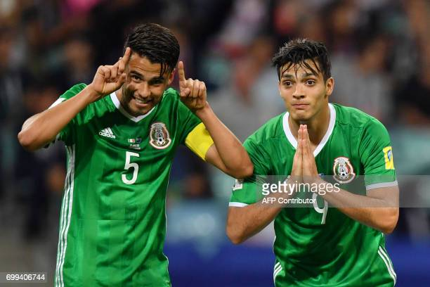TOPSHOT Mexico's forward Raul Jimenez celebrates with Mexico's defender Diego Reyes after scoring a goal during the 2017 Confederations Cup group A...