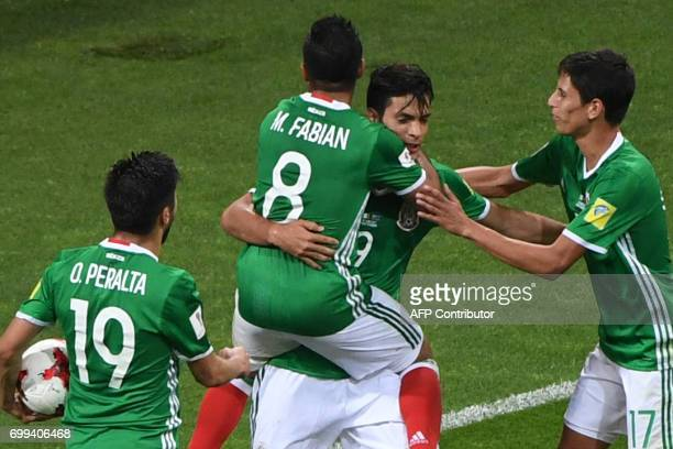 Mexico's forward Raul Jimenez celebrates with Mexico's forward Marco Fabian after scoring a goal during the 2017 Confederations Cup group A football...