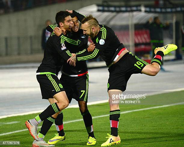 Mexico's forward Raul Jimenez celebrates with teammates Jesus Manuel Corona and Matias Vuoso after scoring against Chile during their 2015 Copa...