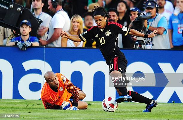 Mexico's Giovani DosSantos drives the ball past USA goalkeeper Tim Howard to score a goal during the CONCACAF 2011 Gold Cup final June 25 2011 at the...