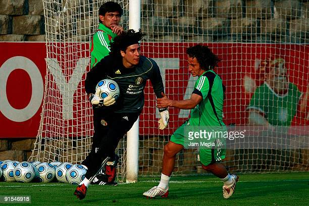 Mexico's goalkeeper Guillermo Ochoa and Andres Guardado during their training session at the Mexican Football Federation's High Performance Center on...
