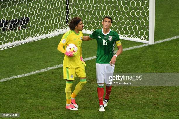 Mexico's goalkeeper Guillermo Ochoa and Mexico's defender Hector Moreno react after conceding a third goal during the 2017 FIFA Confederations Cup...