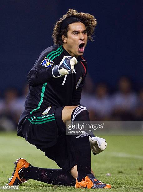 Mexico's goalkeeper Guillermo Ochoa celebrates a stopped penalty against Costa Rica during the 2009 CONCACAF Gold Cup match at the Soldier Field...