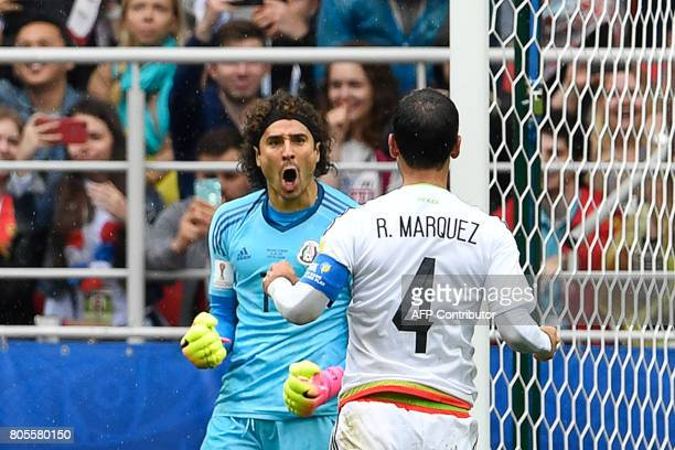 Mexico's goalkeeper Guillermo Ochoa celebrates with Mexico's defender Rafael Marquez after saving a penalty kick during the 2017 FIFA Confederations...