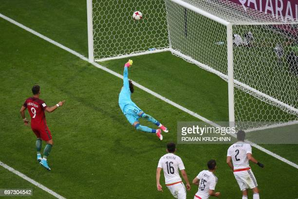 TOPSHOT Mexico's goalkeeper Guillermo Ochoa fails to stop a goal by Portugal's defender Cedric during the 2017 Confederations Cup group A football...