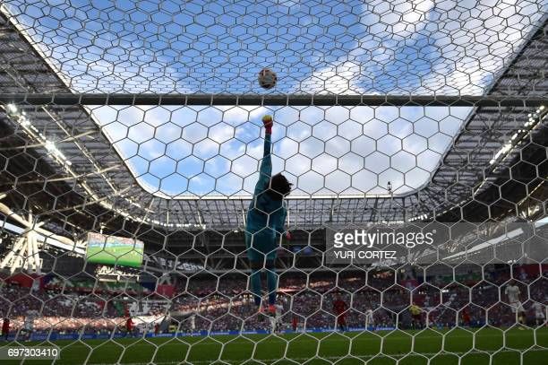 TOPSHOT Mexico's goalkeeper Guillermo Ochoa jumps for the ball during the 2017 Confederations Cup group A football match between Portugal and Mexico...