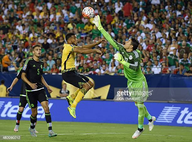 Mexico's goalkeeper Guillermo Ochoa knocks the ball away from Jamaica's Adrian Mariappa during the 2015 CONCACAF Gold Cup final between Jamaica and...