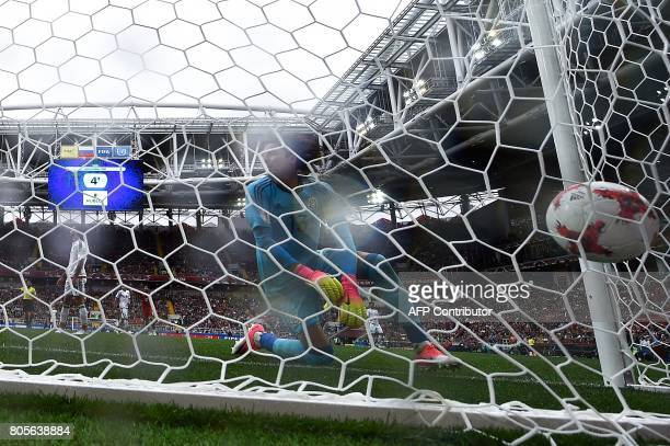 Mexico's goalkeeper Guillermo Ochoa reacts as Portugal score a goal during the 2017 FIFA Confederations Cup third place football match between...