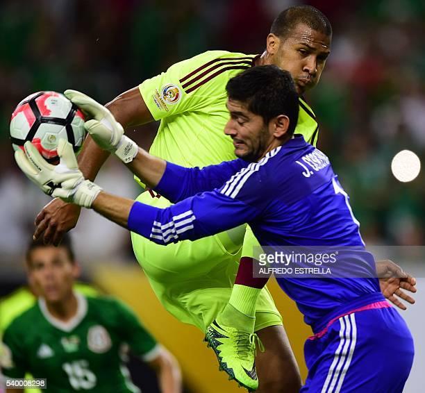 Mexico's goalkeeper Jesus Corona catches the ball next to Venezuela's Jose Salomon Rondon during their Copa America Centenario football tournament...