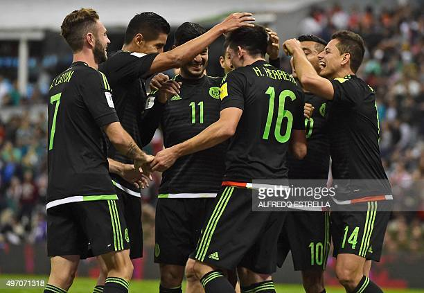 Mexico's Hector Herrera celebrates with teammated after scoring against El Salvador during their Russia 2018 FIFA World Cup Concacaf Qualifiers...