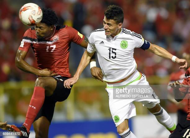 TOPSHOT Mexico's Hector Moreno and Trinidad and Tobago's defender Mekeil Williams vie for the ball during their 2018 FIFA World Cup qualifier...