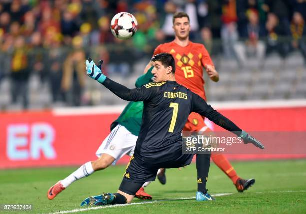 Mexico's Hirving Lozano vies with Belgium's goalkeeper Thibaut Courtois during the international friendly football match between Belgium and Mexico...