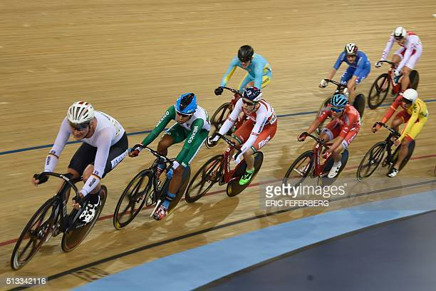 Mexico's Ignacio Prado Belarus' Raman Ramanau and Hong Kong's King Lok Cheung compete in the Men's Scratch final during the 2016 Track Cycling World...