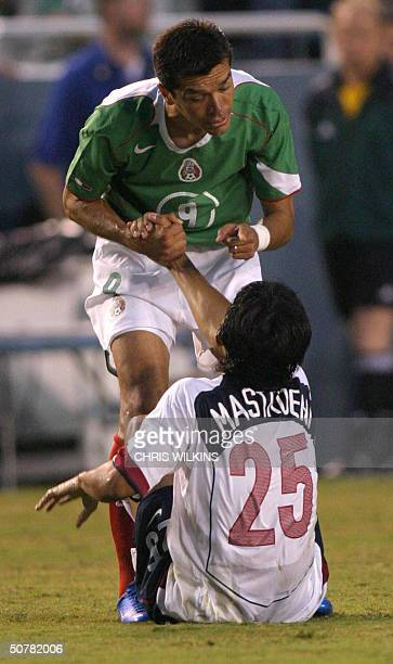 Mexico's Jared Borgetti has words with Pablo Mastroeni of the US after a first half collision during the international friendly men's soccer match...