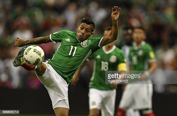 Mexico's Javier Aquino controls the ball during their Russia 2018 FIFA World Cup CONCACAF qualifiers football match against Honduras at the Azteca...