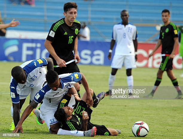 Mexico's Javier Aquino is fouled during the Russia 2018 FIFA World Cup Concacaf Qualifiers football match in San Pedro Sula on November 17 2015 AFP...