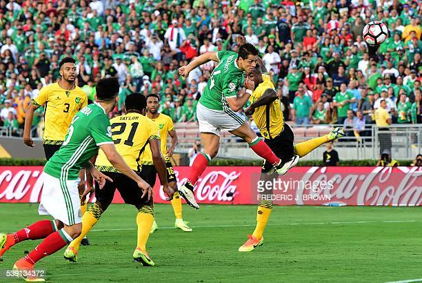 TOPSHOT Mexico's Javier 'Chicharito' Hernandez scores a header against Jamaica during their Copa America Centenario football tournament match in...