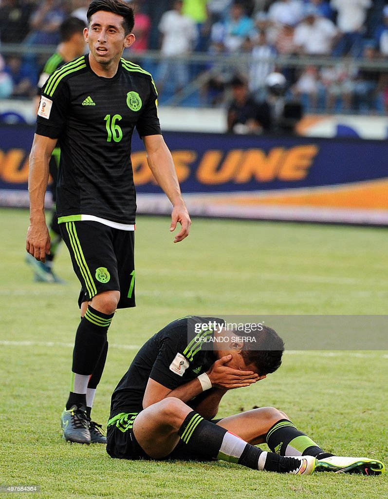Mexico s Javier Hernandez R gestures next to Mexico s Hector