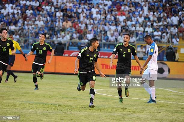 Mexico's Jesus Corona celebrates with Diego Reyes after scoring against Honduras during the Russia 2018 FIFA World Cup Concacaf Qualifiers football...