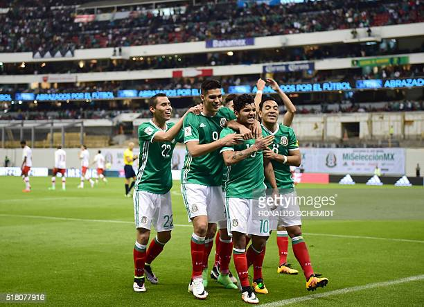 Mexico's Jesus Corona celebrates with teammates after scoring against Canada during their Russia 2018 FIFA World Cup Concacaf Qualifiers' football...