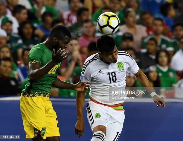 Mexico's Jesus Gallardo clashes with Jamaica's Kemar Lawrence during the Mexico vs Jamaica CONCACAF Group C Gold Cup soccer game on July 13 2017 at...