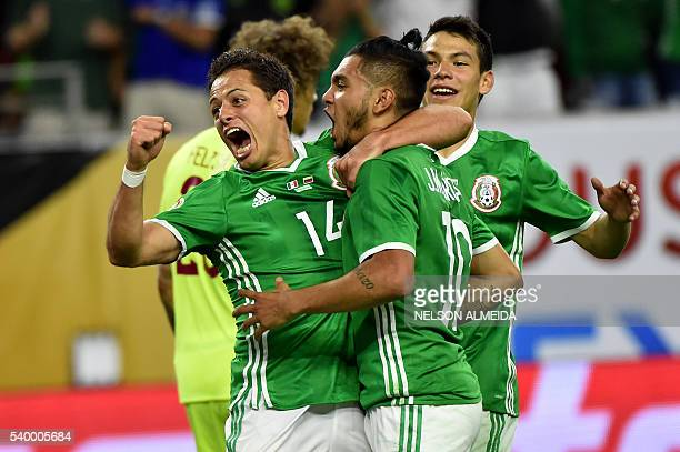 Mexico's Jesus Manuel Corona celebrates with teammate Javier 'Chicharito' Hernandez after scoring against Venezuela during their Copa America...