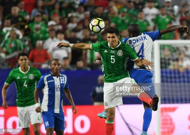 Mexico's Jesus Molina heads the ball beside Oscar Boniek Garcia from Honduras in their quarter final game during the 2017 CONCACAF Gold Cup at the...