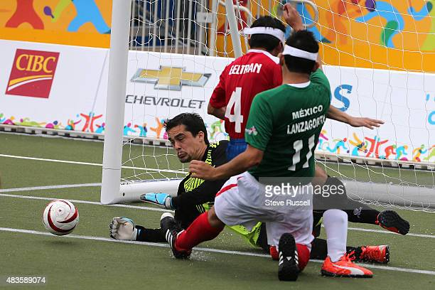 TORONTO ON AUGUST 10 Mexico's Jorge Lanzagorta comes close to scoring on Benjamin Cruz as the Mexico beats Chile 21 in Fiveaside soccer at the...
