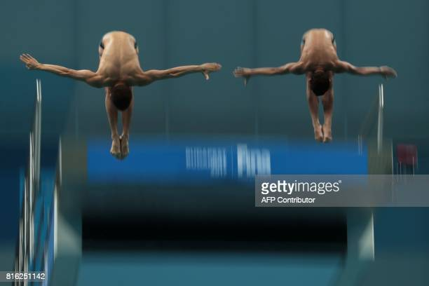 Mexico's Jose Diego Balleza Isaias and Mexico's Kevin Berlin Reyes compete in the men's 10m platform synchro final during the diving competition at...