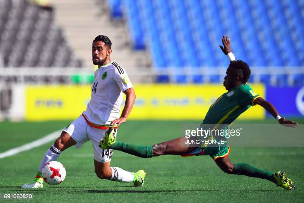 Mexico's Jose Esquivel fights for the ball with Senegal's Ibrahima Ndiaye during their U20 World Cup round of 16 football match between Mexico and...