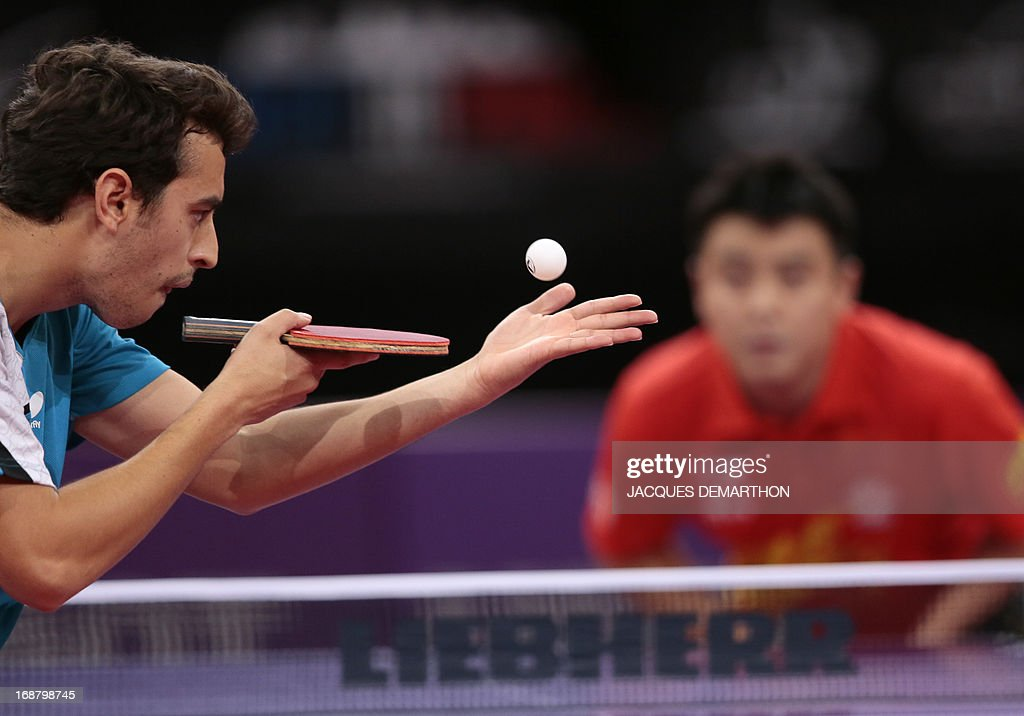 Mexico's Marcos Madrid serves to China's Wang Hao on May 15, 2013 in Paris during the first round of the Men's Singles of the World Table Tennis Championships. DEMARTHON