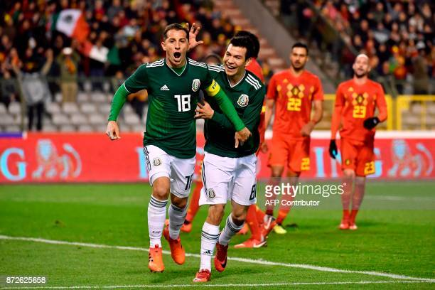 Mexico's midfielder Andres Guardado celebrates with Mexico's midfielder Hirving Lozano after scoring a goal during the international friendly...