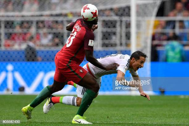 Mexico's midfielder Andres Guardado challenges Portugal's midfielder Danilo during the 2017 FIFA Confederations Cup third place football match...