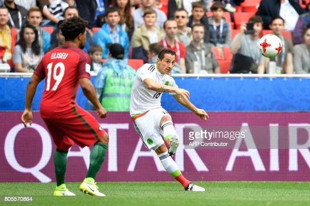 Mexico's midfielder Andres Guardado kicks the ball past Portugal's defender Eliseu during the 2017 FIFA Confederations Cup third place football match...