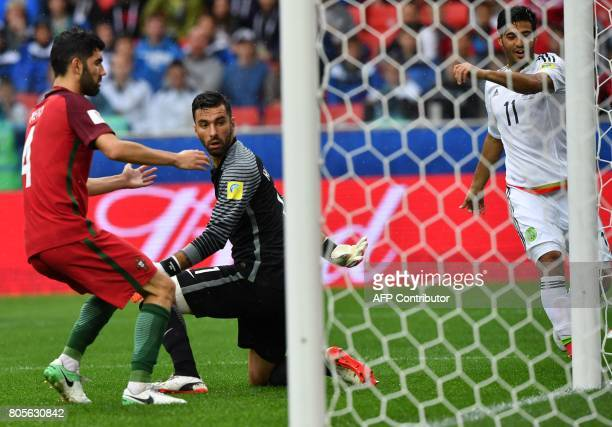 TOPSHOT Mexico's midfielder Carlos Vela celebrates as Portugal's defender Luis Neto reacts next to Portugal's goalkeeper Rui Patricio after scoring...