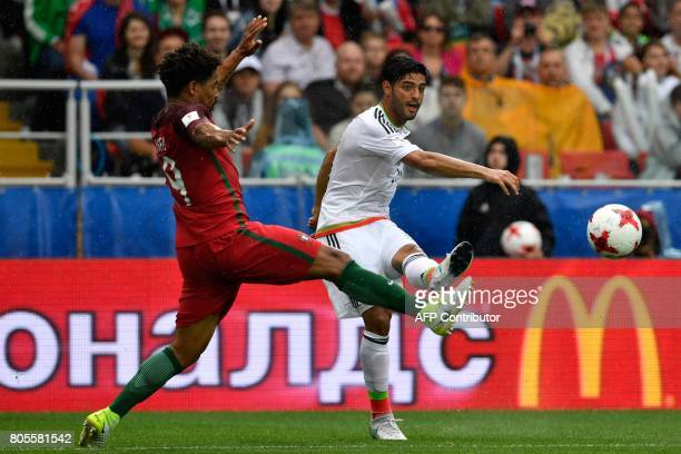 Mexico's midfielder Carlos Vela shoots the ball in front of Portugal's defender Eliseu during the 2017 Confederations Cup third place football match...