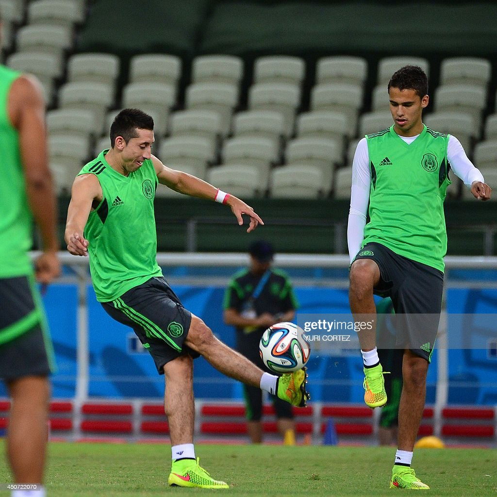 Mexico s midfielder Hector Herrera L and Mexico s defender Diego