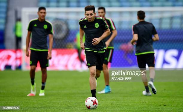 Mexico's midfielder Hector Herrera runs with a ball during a training session at the Fisht stadium in Sochi on June 20 2017 on the eve of the 2017...