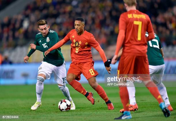 Mexico's midfielder Hector Herrera vies for the ball with Belgium's midfielder Youri Tielemans during the international friendly football match...