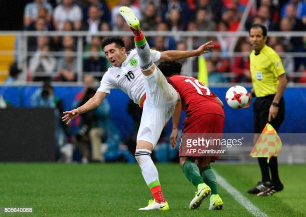 Mexico's midfielder Hector Herrera vies with Portugal's defender Eliseu during the 2017 Confederations Cup third place football match between...