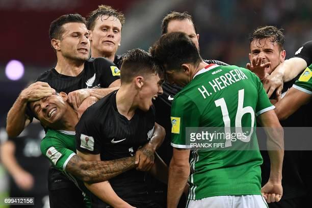 Mexico's midfielder Javier Aquino and Mexico's midfielder Hector Herrera fight with New Zealand's midfielder Ryan Thomas and New Zealand's forward...