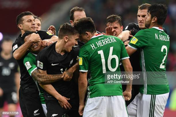 TOPSHOT Mexico's midfielder Javier Aquino and Mexico's midfielder Hector Herrera fight with New Zealand's midfielder Ryan Thomas and New Zealand's...
