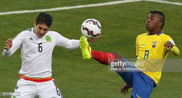 Mexico's midfielder Javier Guemez and Ecuador's forward Miller Bolaños vie for the ball during their 2015 Copa America football championship match in...