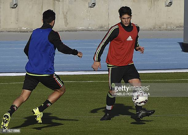 Mexico's midfielder Javier Guemez controls the ball during a training session at the El Teniente stadium in Rancagua Chile on June 18 on the eve of...