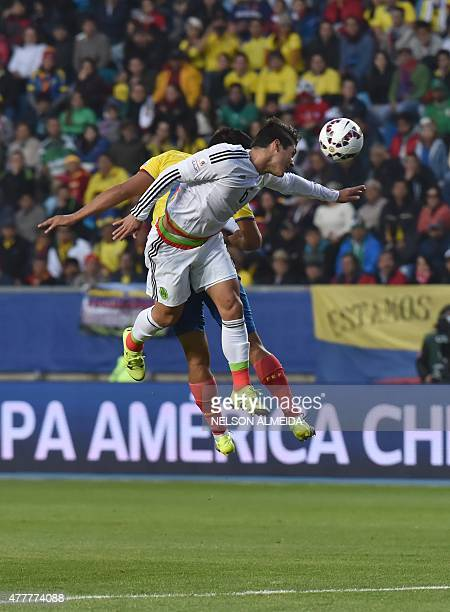 Mexico's midfielder Javier Guemez jumps for the ball with an Ecuadorean player during their 2015 Copa America football championship match in Rancagua...