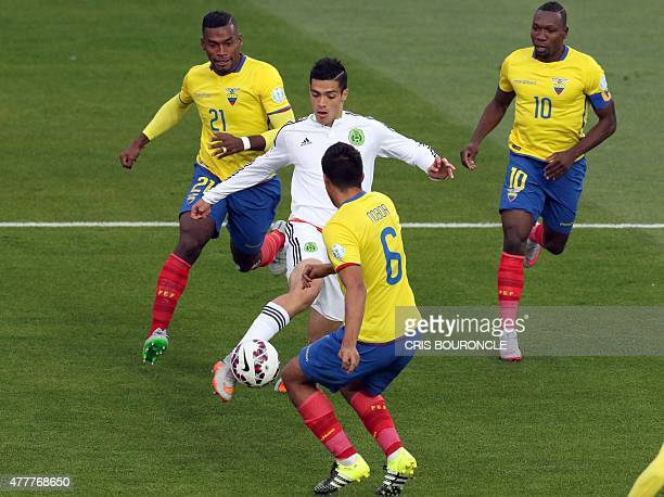 Mexico's midfielder Javier Guemez tries to control the ball surrounded by Ecuador's defender Gabriel Achilier and Cristian Noboa during their 2015...