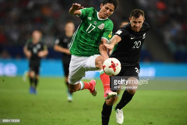 Mexico's midfielder Juergen Damm vies with New Zealand's defender Tommy Smith during the 2017 Confederations Cup group A football match between...