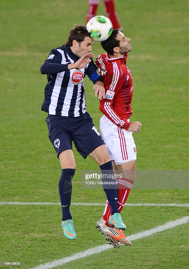 Mexico's Monterrey captain and defender Jose Maria Basanta fights for the ball with Egypt's Al Ahly forward Mohamed Aboutrika during the 2012 Club...
